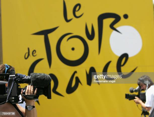 Tv camera men are seen in front of a Tour de France banner during stage eleven of the Tour de France from Marseille to Montpellier on July 19 2007 in...