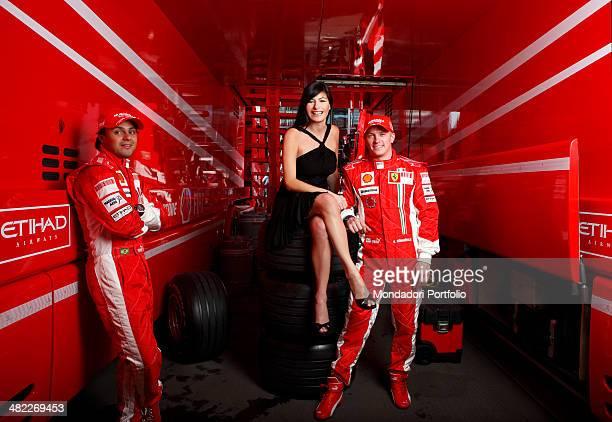 Tv host Ilaria D'Amico from Sky Sport and Formula One racing drivers Felipe Massa and Kimi Raikkonen posing in Ferrari's box Montmelo Spain April...