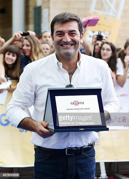 Tv host Max Giusti poses with the Giffoni Award on July 24 2014 in Giffoni Valle Piana Italy