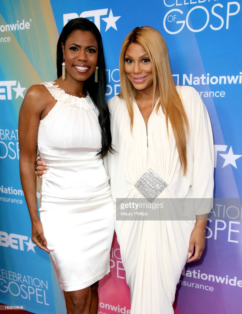 Tv personalites Omarosa Manigault (L) and Tamar Braxton attend the BET Celebration of Gospel 2013 at Orpheum Theatre on March 16, 2013 in Los Angeles, California.
