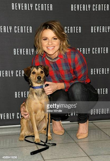 Tv personality Ali Fedotowsky and her dog Owen attend the Beverly Center's Holiday Pet Portraits Debut on November 13 2014 in Los Angeles California