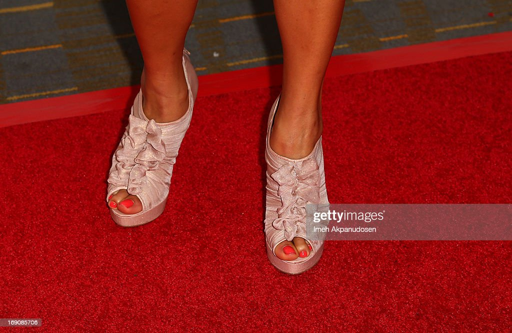 Tv personality Angela Sun (shoe detail) attends the 28th Anniversary Sports Spectacular Gala at the Hyatt Regency Century Plaza on May 19, 2013 in Century City, California.
