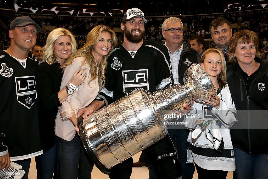Tv personality Erin Andrews and Jarret Stoll of the Los Angeles Kings celebrate with family and the Stanley Cup after the Kings 32 double overtime...