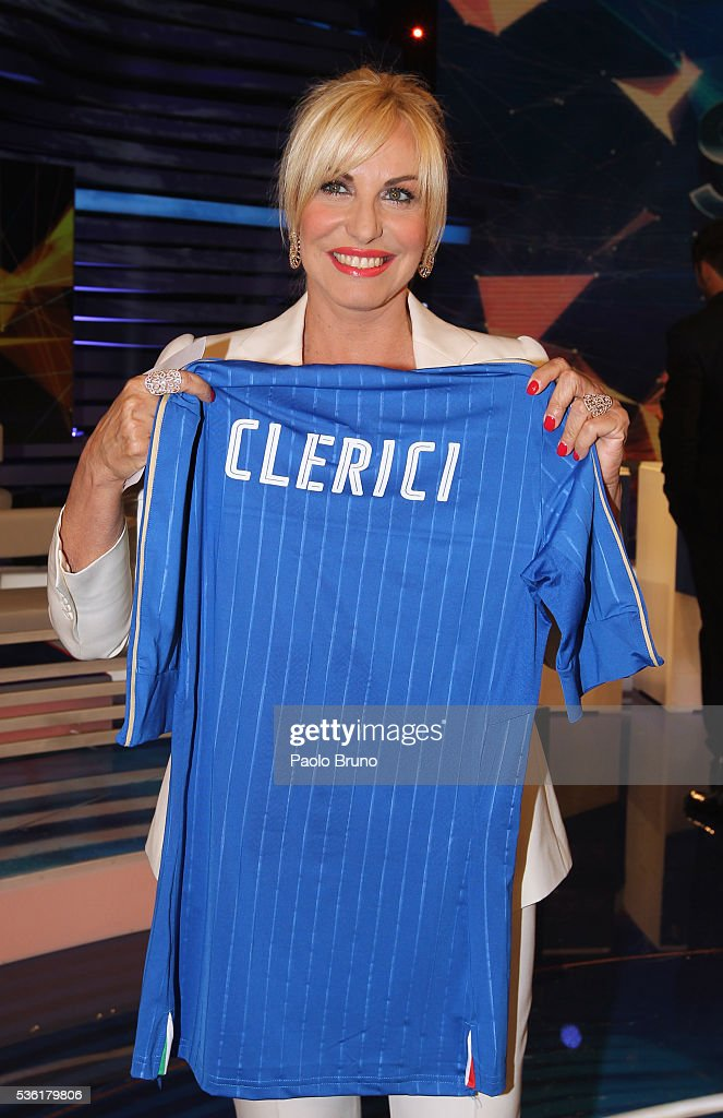 Tv presenter <a gi-track='captionPersonalityLinkClicked' href=/galleries/search?phrase=Antonella+Clerici&family=editorial&specificpeople=2544073 ng-click='$event.stopPropagation()'>Antonella Clerici</a> poses with Italian jersey during the 'Sogno Azzurro' TV programme at Auditorium del Foro Italico on May 31, 2016 in Rome, Italy.