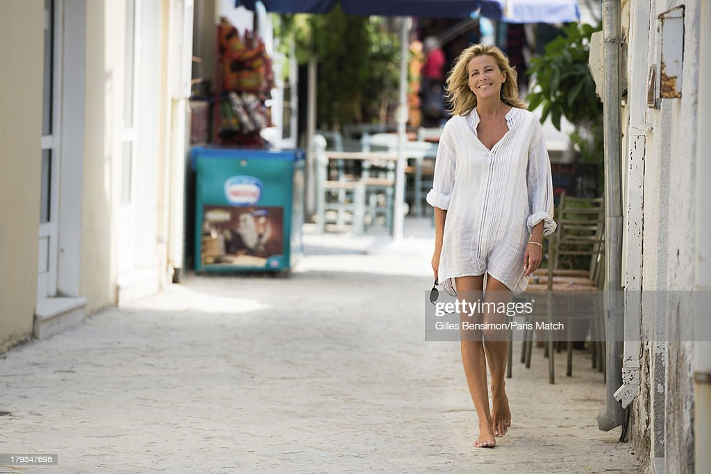 Tv presenter Claire Chazal is photographed on the Greek island of Paxos for Paris Match on August 16, 2013 in Greece.