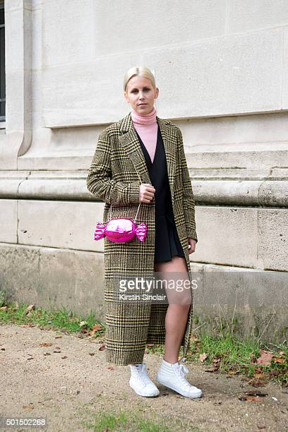 Tv Presenter Elke Sockeel wears a Kate spade bag Pinko sweater and jacket H and M dress and Vans trainers on day 8 during Paris Fashion Week...