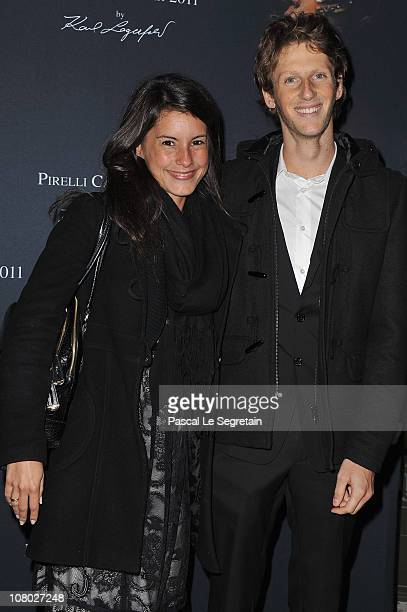 Tv Presenter Marion Jolles and Romain Grosjean attend the Pirelli 2011 Calendar launch at Le Mini Palais on January 13 2011 in Paris France