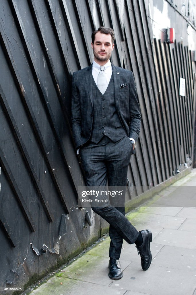 Tv Presenter Stephen Kelly wears a River Island suit, vintage shoes and tie, and a Saville Row shirt day 3 of London Mens Fashion Week Autumn/Winter 2014, on January 08, 2014 in London, England.
