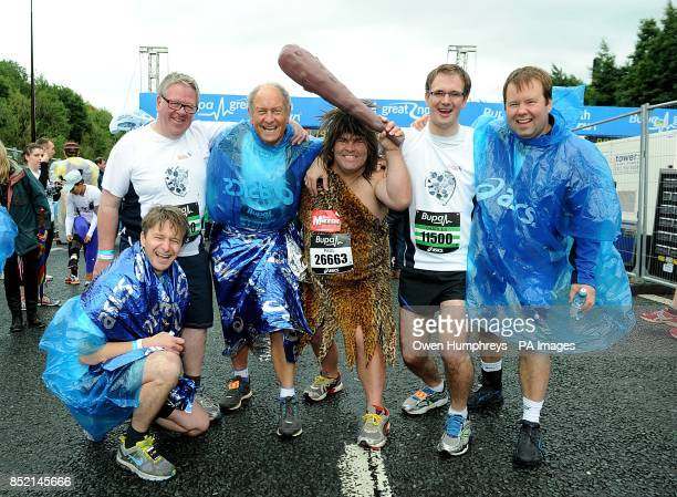 Tv Presenters from the Antquies Roadshow pose with Paul Waugh from Teeside dressed as Captain Caveman prior to the 2013 Great North Run between...