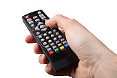 Photo of human hand holding tv remote control