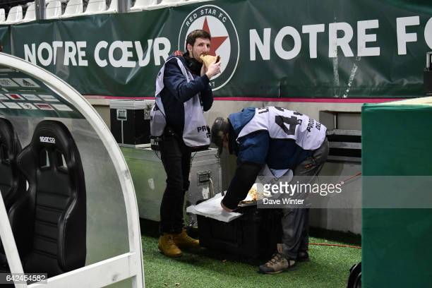 Tv technicians enjoying a pizza during the French Ligue 2 match between Red Star and Strasbourg at Stade Jean Bouin on February 17 2017 in Paris...