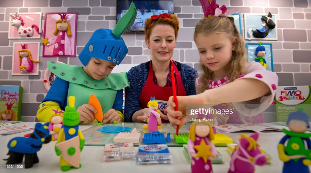 TV-host Enie van de Meiklokjes and the two children Amalia and Leopold show how to play with 'FIMO kids form and play'-sets at the exhibition stand of 'Staedtler' during the Press-Preview of the Nuremberg International Toy Fair 2014 (Nuernberger Spielwarenmesse) on January 28, 2014 in Nuremberg, Germany. The Nuremberg International Toy Fair 2014 is the worlds biggest toy fair and is open to visitors from January 29 to February 3.
