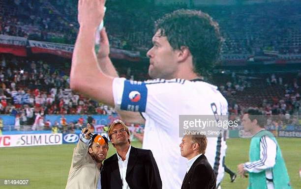 TVhosts Urs Meier Juergen Klopp and Johannes B Kerner are seen after the UEFA EURO 2008 Group B match between Germany and Poland at the TV studio of...