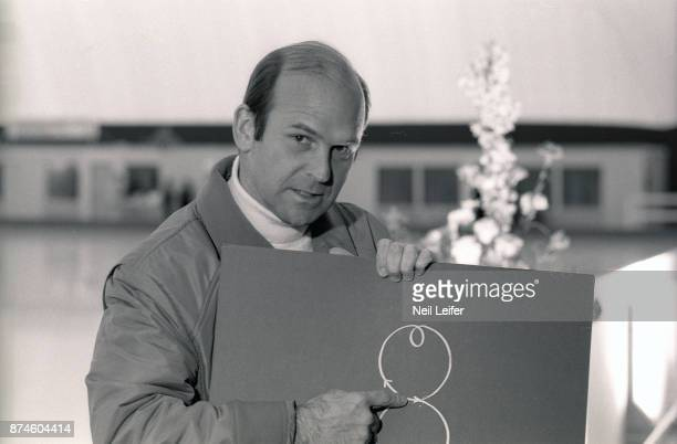 Portrait of ABC figure skating announcer Dick Button holding and pointing at diagram on board at Olympiahalle Innsbruck Austria 2/12/1976 CREDIT Neil...