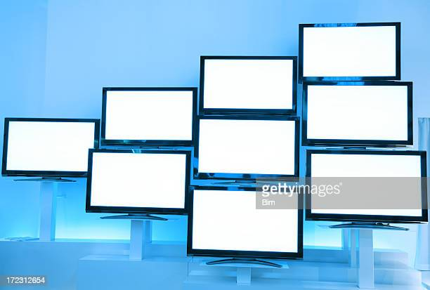 LCD TVs in a Row on Wall