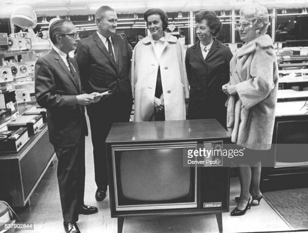 TVs Introduced Winners of the top prizes in a giveaway which marked the preview of 1967 home entertainment appliances by Downings lnc receive awards...