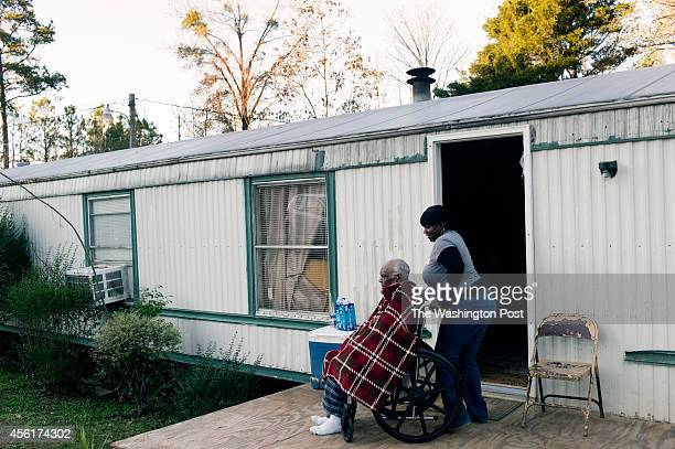 Twanda Blount helps her grandfather Chocolate Blount maneuver his wheelchair outside their trailer home Chocolate Blount who is 91 was discharged...