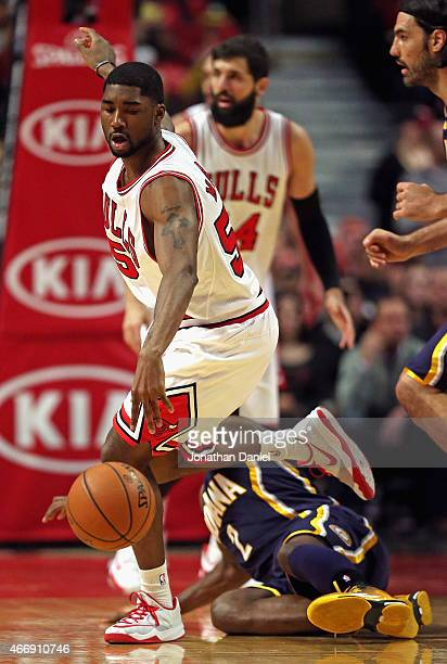 Twaun Moore of the Chicago Bulls chases Indiana Pacers ball dropped by Rodney Stuckey of the Indiana Pacers at the United Center on March 18 2015 in...
