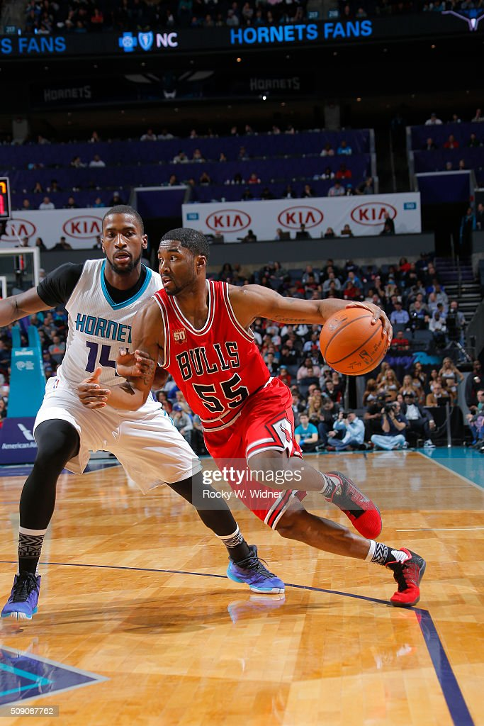 E'twaun Moore #55 of the Chicago Bulls drives against <a gi-track='captionPersonalityLinkClicked' href=/galleries/search?phrase=Michael+Kidd-Gilchrist&family=editorial&specificpeople=8526214 ng-click='$event.stopPropagation()'>Michael Kidd-Gilchrist</a> #14 of the Charlotte Hornets on Februay 8, 2016 at Time Warner Cable Arena in Charlotte, North Carolina.