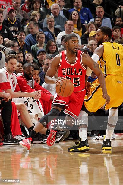 Twaun Moore of the Chicago Bulls drives against the Indiana Pacers on December 29 2014 at Bankers Life Fieldhouse in Indianapolis Indiana NOTE TO...