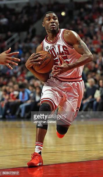 Twaun Moore of the Chicago Bulls drives into the lane against the New York Knicks at the United Center on January 1 2016 in Chicago Illinois The...