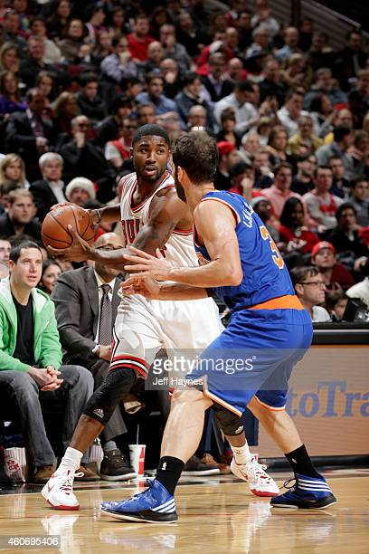 Twaun Moore of the Chicago Bulls handles the ball against the New York Knicks at the United Center on December 18 2014 in Chicago Illinois NOTE TO...