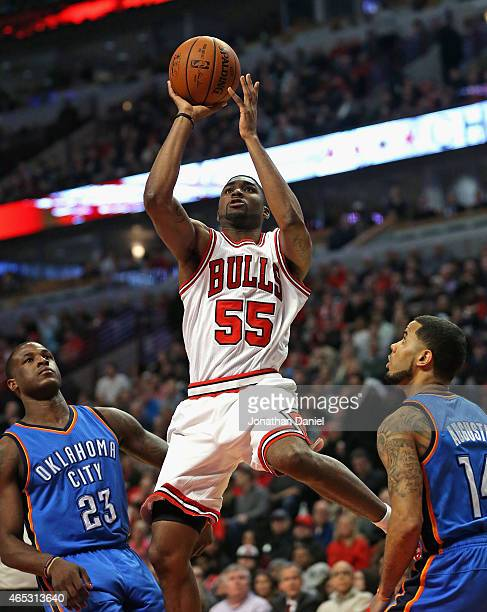 Twaun Moore of the Chicago Bulls puts up a shot between Dion Waiters and DJ Augustin of the Oklahoma City Thunder at the United Center on March 5...