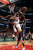 Twaun Moore of the Chicago Bulls shoots against Rodney Stuckey and Ian Mahinmi of the Indiana Pacers on March 18 2015 at the United Center in Chicago...
