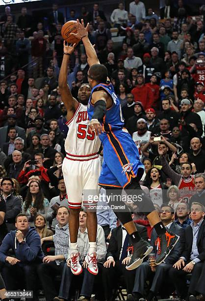 Twaun Moore of the Chicago Bulls shoots the gamewinning three point shot against Russell Westbrook of the Oklahoma City Thunder at the United Center...