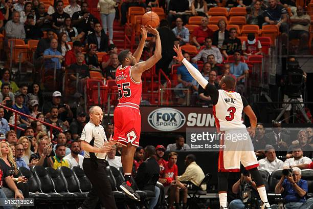 Twaun Moore of the Chicago Bulls shots against Dwyane Wade of the Miami Heat during the game on March 1 2016 at American Airlines Arena in Miami...