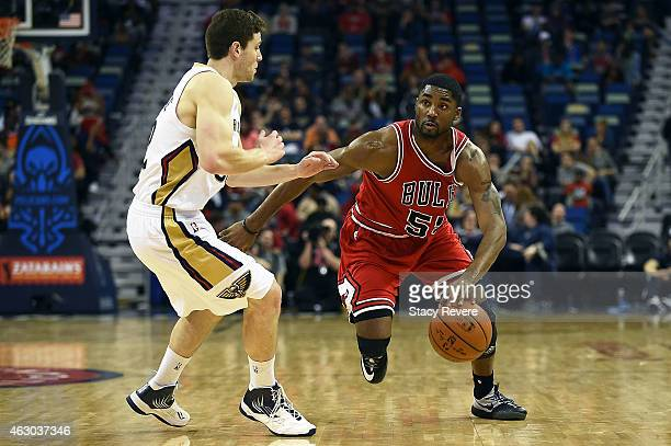 Twaun Moore of the Chicago Bulls works against Jimmer Fredette of the New Orleans Pelicans during the second half of a game at the Smoothie King...