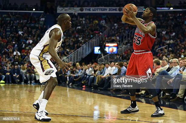 Twaun Moore of the Chicago Bulls works against Quincy Pondexter of the New Orleans Pelicans during the second half of a game at the Smoothie King...
