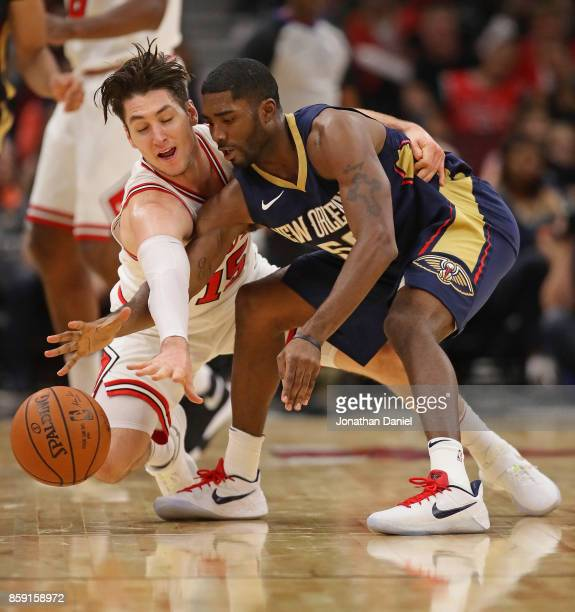 Twaun Moore of the New Orleans Pelicans and Ryan Arcidiacono of the Chicago Bulls battle for the ball during a preseason game at the United Center on...