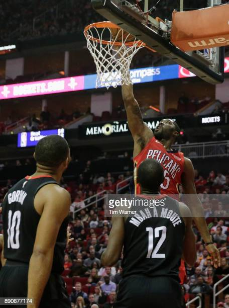 Twaun Moore of the New Orleans Pelicans shoots a lay up in the second half defended by Luc Mbah a Moute of the Houston Rockets and Eric Gordon at...