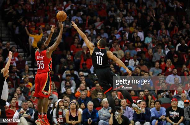 Twaun Moore of the New Orleans Pelicans shoots a three point shot defended by Eric Gordon of the Houston Rockets in the first half at Toyota Center...
