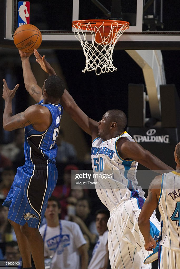 E´Twaun Moore of the Orlando Magic 55 goes to the basket against Salomon Alabi #50 of New Orleans Hornets, during the game between the Orlando Magic and the New Orleans Hornets on October 7, 2012 at Mexico City Arena in Mexico City.