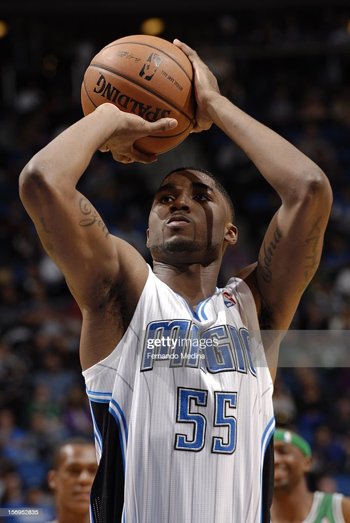 E'Twaun Moore #55 of the Orlando Magic aims for a free throw during the game between the Boston Celtics and the Orlando Magic on November 25, 2012 at Amway Center in Orlando, Florida.