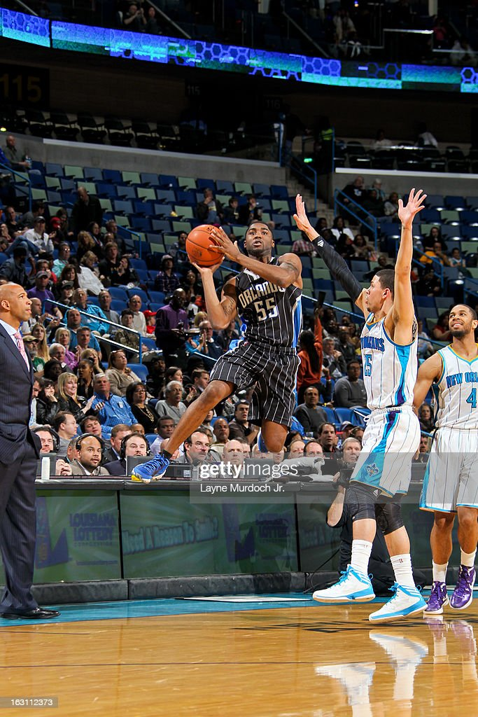 E'Twaun Moore #55 of the Orlando Magic attempts a three-pointer against Austin Rivers #25 of the New Orleans Hornets on March 4, 2013 at the New Orleans Arena in New Orleans, Louisiana.