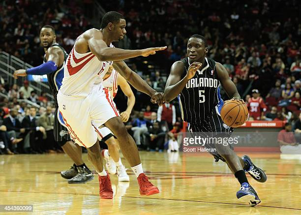 Twaun Moore of the Orlando Magic drives past Terrence Jones of the Houston Rockets at Toyota Center on December 8 2013 in Houston Texas NOTE TO USER...