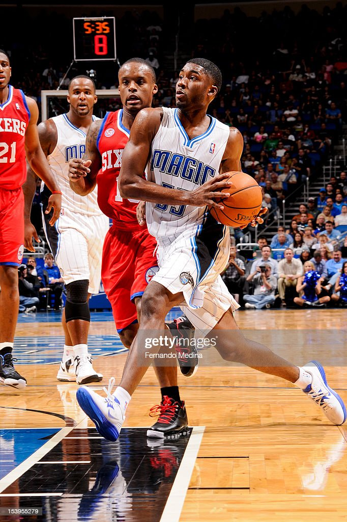 E'Twaun Moore #55 of the Orlando Magic drives to the basket against the Philadelphia 76ers during a pre-season game on October 11, 2012 at Amway Center in Orlando, Florida.