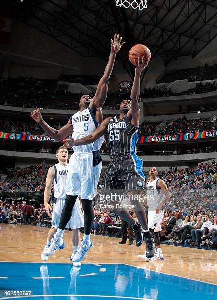 Twaun Moore of the Orlando Magic goes in for the layup against Bernard James of the Dallas Mavericks on January 13 2014 at the American Airlines...