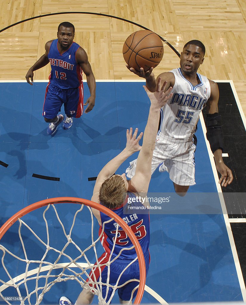 E'Twaun Moore #55 of the Orlando Magic goes to the basket against Kyle Singler #25 of the Detroit Pistons during the game between the Detroit Pistons and the Orlando Magic on January 27, 2013 at Amway Center in Orlando, Florida.