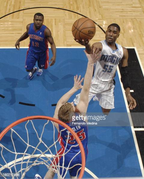 Twaun Moore of the Orlando Magic goes to the basket against Kyle Singler of the Detroit Pistons during the game between the Detroit Pistons and the...