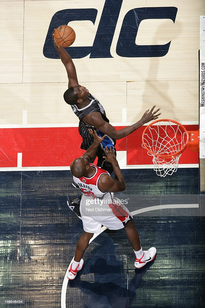 <a gi-track='captionPersonalityLinkClicked' href=/galleries/search?phrase=E%27Twaun+Moore&family=editorial&specificpeople=4877476 ng-click='$event.stopPropagation()'>E'Twaun Moore</a> #55 of the Orlando Magic grabs a rebound against the Washington Wizards at the Verizon Center on January 14, 2013 in Washington, DC.