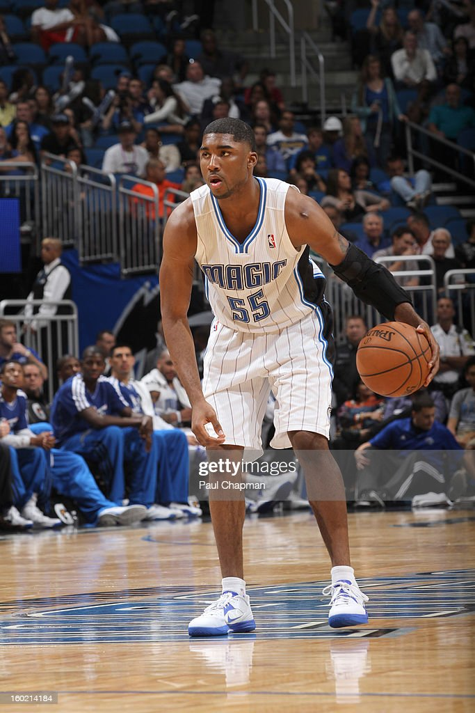 E'Twaun Moore #55 of the Orlando Magic handles the ball during the game between the Detroit Pistons and the Orlando Magic on January 27, 2013 at Amway Center in Orlando, Florida.