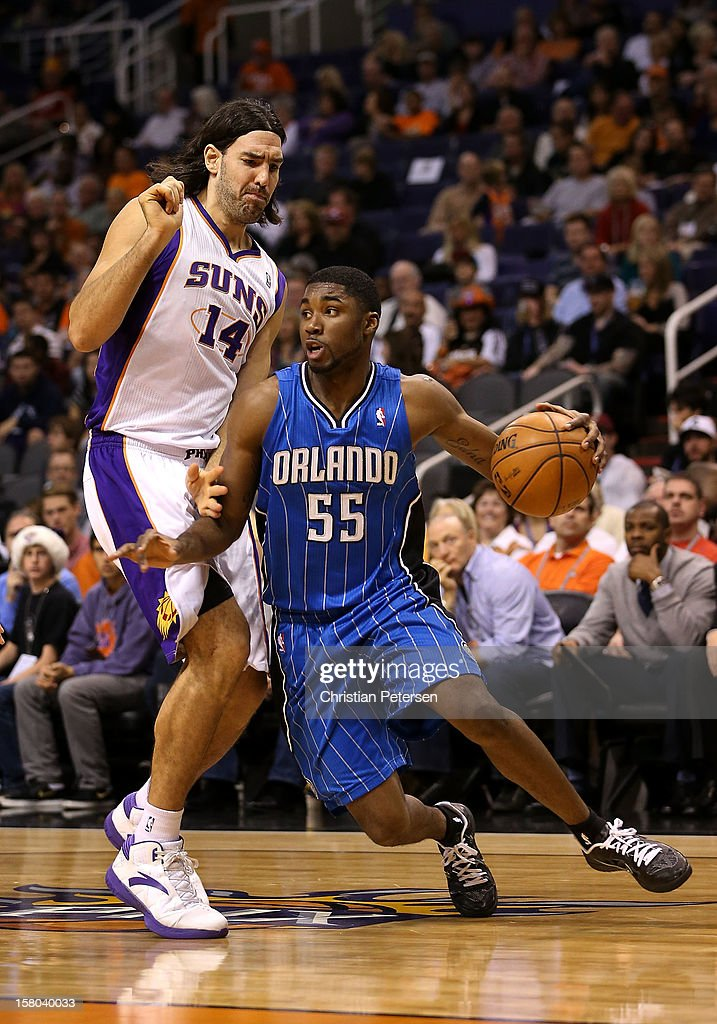 E'Twaun Moore #55 of the Orlando Magic handles the ball under pressure from Luis Scola #14 of the Phoenix Suns during the NBA game at US Airways Center on December 9, 2012 in Phoenix, Arizona.