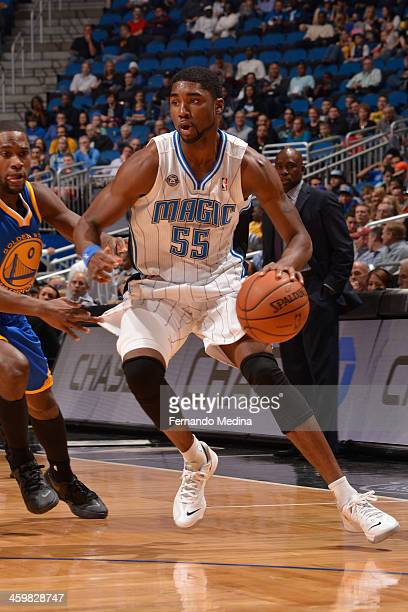 Twaun Moore of the Orlando Magic handles the basketball during a game against the Golden State Warriors on December 31 2013 at Amway Center in...