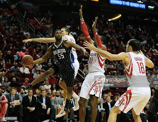 Twaun Moore of the Orlando Magic looks to pass beyond Francisco Garcia Dwight Howard and Omri Casspi of the Houston Rockets at Toyota Center on...