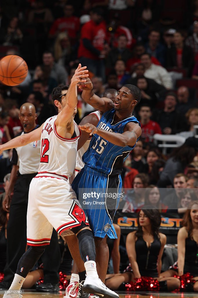 E'Twaun Moore #55 of the Orlando Magic makes a pass against <a gi-track='captionPersonalityLinkClicked' href=/galleries/search?phrase=Kirk+Hinrich&family=editorial&specificpeople=201629 ng-click='$event.stopPropagation()'>Kirk Hinrich</a> #12 of the Chicago Bulls on November 6, 2012 at the United Center in Chicago, Illinois.