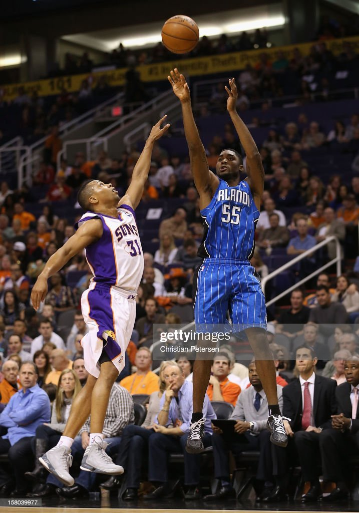 E'Twaun Moore #55 of the Orlando Magic puts up a three point shot over Sebastian Telfair #31 of the Phoenix Suns during the NBA game at US Airways Center on December 9, 2012 in Phoenix, Arizona.